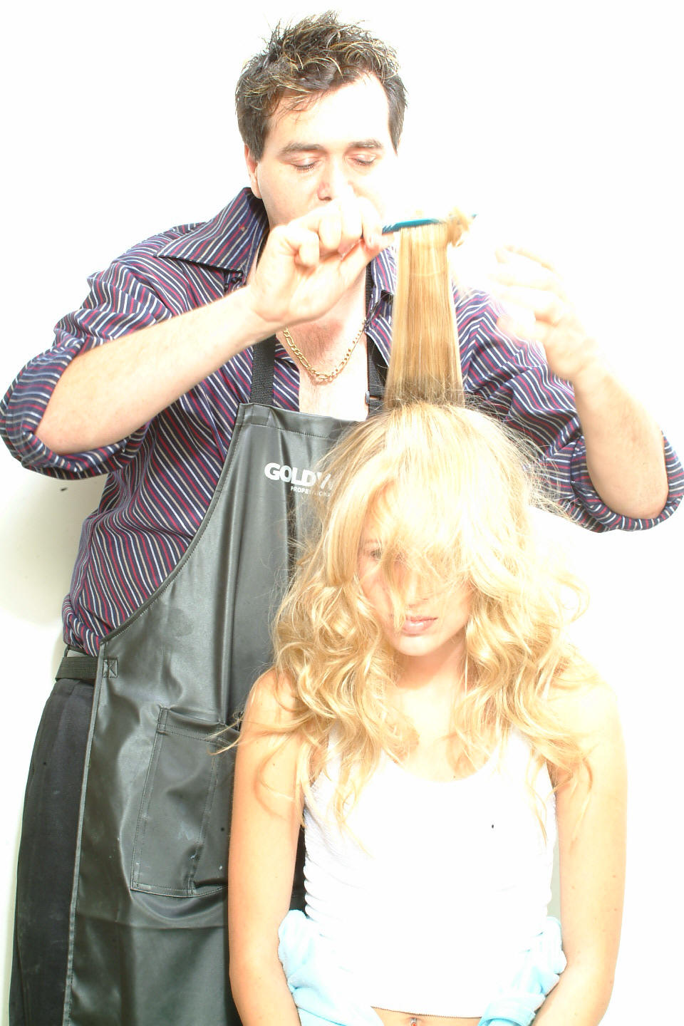 Hairstylist Lanza and long golden hair styled wiht long messy layers.